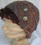 Rachel_worsted_weight_in_earthen_jewel_tones_front_view_with_buttons__back_brim_up_2