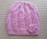 Pink_hat_in_eyelet_panels_and_knit_rose_for_a_lady_2